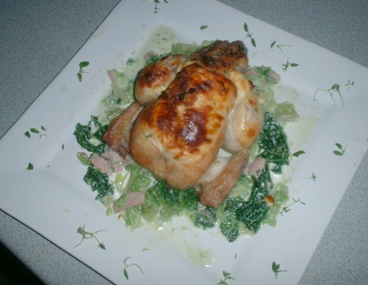 Poussin with cheese stuffed skin, creamed savoy cabbage