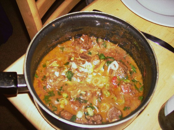 curried goat in pot
