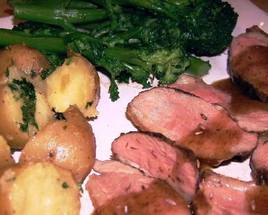 rare duck breast with lavender honey sauce, new potatoes and purple sprouting broccoli