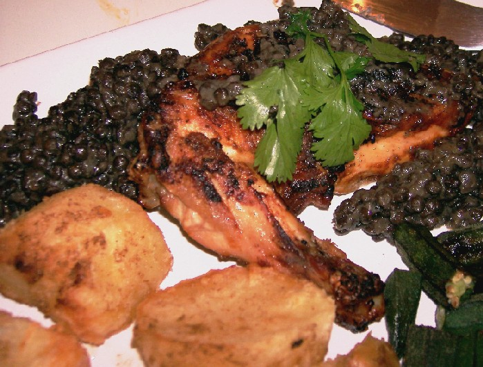 tandoori roast chicken with spiced potatoes and black lentil sauce
