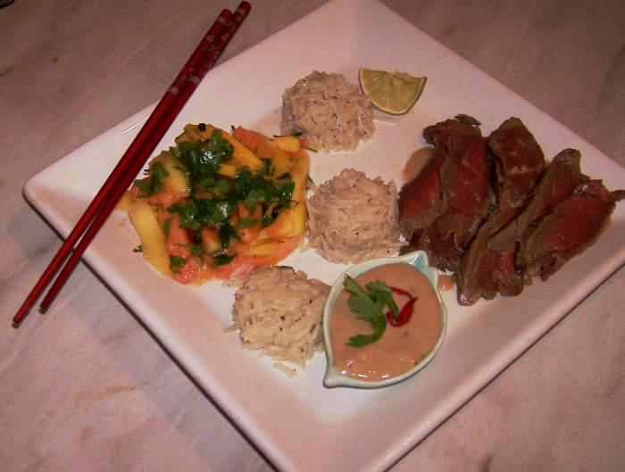 beef sashimi, coconut rice, peanut sauce mango and papaya salad